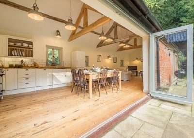 Bi-fold doors opening on to Bear's Cottage kitchen