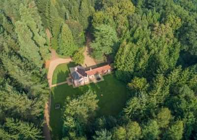 Aerial view of Bear's Cottage, a secluded holiday cottage in the Norfolk countryside