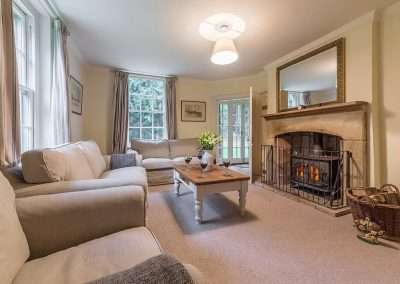 Open fire in the snug at Bear's Cottage holiday home in Norfolk