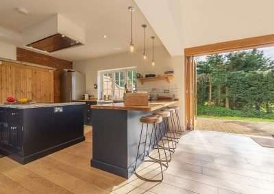 The kitchen at Gardener's Cottage opens onto the tranquil country estate surroundings