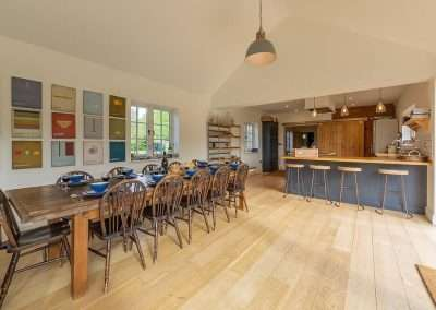 The large dining room at Gardener's Cottage easily seats the 10 guests in this large holiday home in Norfolk