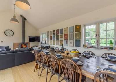 The dining and living area at Gardener's Cottage, perfect for group or family holidays to Norfolk