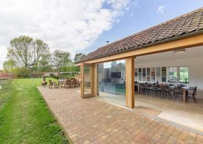 The bifold doors from Gardener's Cottage open up onto the country estate and garden