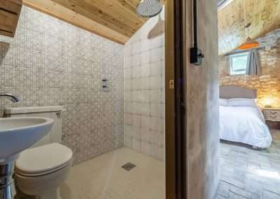 Beautifully tiles bathroom at Potting Shed holiday cottage in north west Norfolk