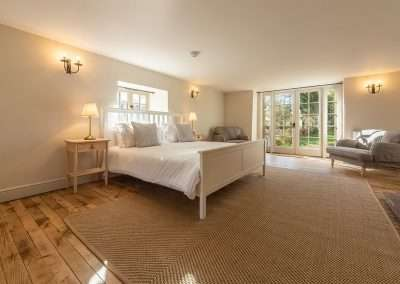 The double bedroom at Market Square House opens up on the peaceful garden