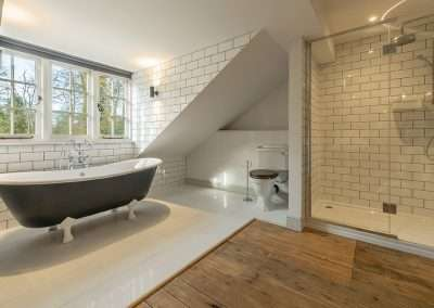Beautiful bathroom with claw foot bath and modern shower at Market Square House in Norfolk
