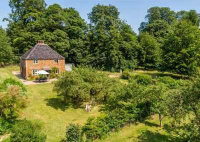 Image shows Park Cottage and its beautiful forest surroundings