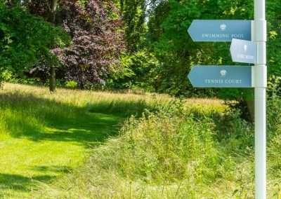 Signage near Park Cottage displaying Fring Estate amenities